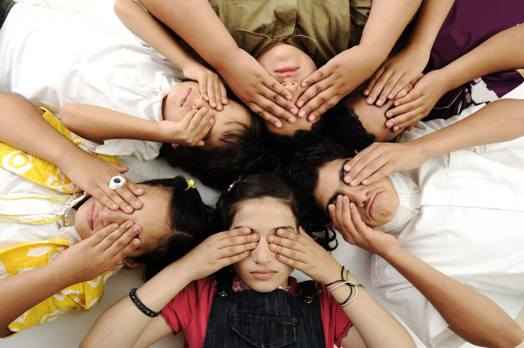 Group of happy children with closed eyes